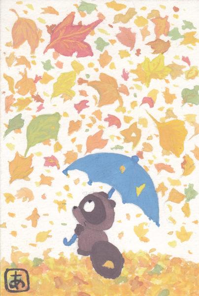 落ち葉の雨を傘で受け止めるタヌキのイラスト